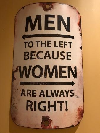 Cute sign hung between washrooms at Joey's Pub.