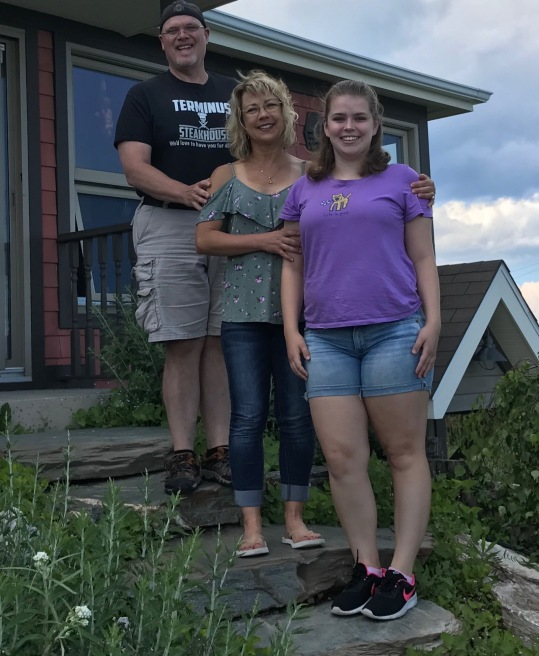 John, me, and Madelyn in front of the charming vacation home we found on Airbnb, owned by Denise, in Petite Rocher area of New Brunswick.