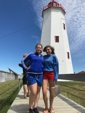 Maddie and Gracie B. stand in front of Miscuo Island Lighthouse--a place we visited after meeting and talking with Chris, a staff member of Joey's Pub in Bathurst, New Brunswick.