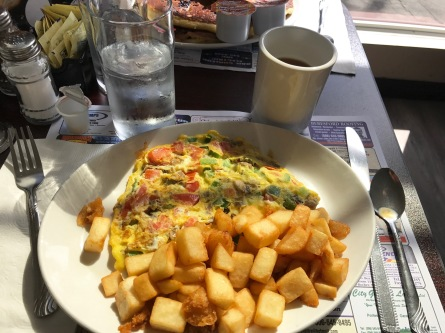 My yummy vegetable omelet served with plenty of potatoes and coffee!