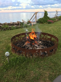 Starting the campfire before darkness falls. Petit Rocher neighbors would stop by this campfire during the evenings to chat.