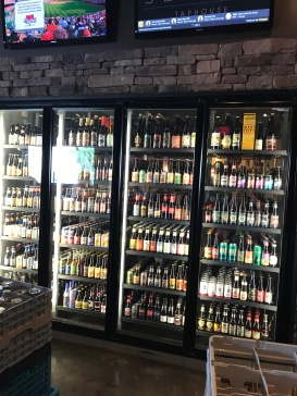 There were two cases of beer on either side of the tap--all with different types of craft beer and ciders.