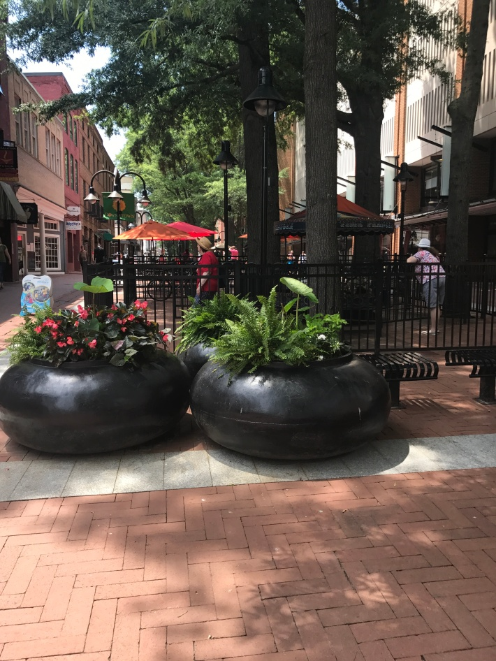 Historic Charlottesville Pedestrian Mall is lined with red bricked and loaded with shops, local eateries, a museum, pavilion, Welcome Center, and a free bus running between the mall and UVA.
