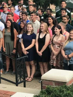 Maddie & one of her roommates, Tatum, joining in on the group picture of the class of 2021.