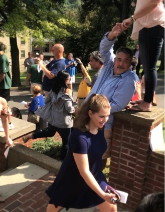 Maddie walks past in the Matriculation of first year Bethany students.