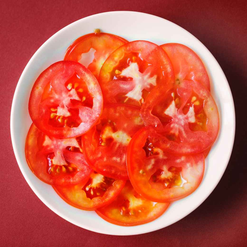 top view photography of sliced tomatoes