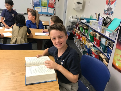 Simon Marchal decided to immerse himself in a previously read favorite book he found in my classroom.
