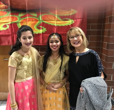 Angelina Bir, Nishi Chow dhury smile with me. They are two of our current students.