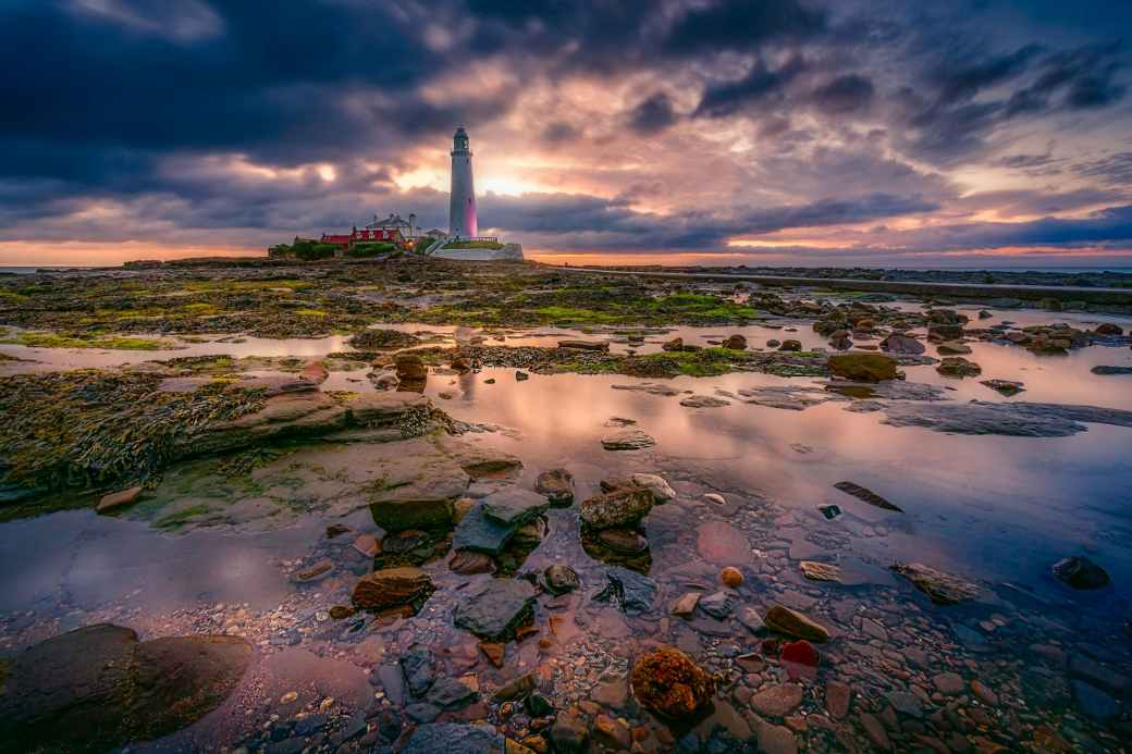 landscape photography of white lighthouse during cloudy daytime