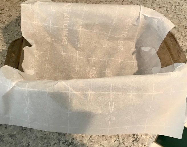 Line the loaf pan with parchment paper.
