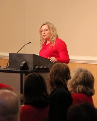 Angel Schneider speaking at the 2020 Go Red luncheon sponsored by St. Mary's Medical Center.