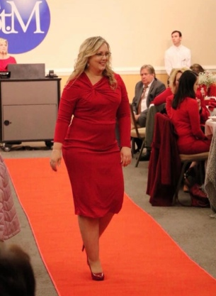 Angel Schneider modeling a red dress at the 2020 Go Red luncheon sponsored by St. Mary's Medical Center.